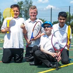 Pupils playing tennis at Elms Bank
