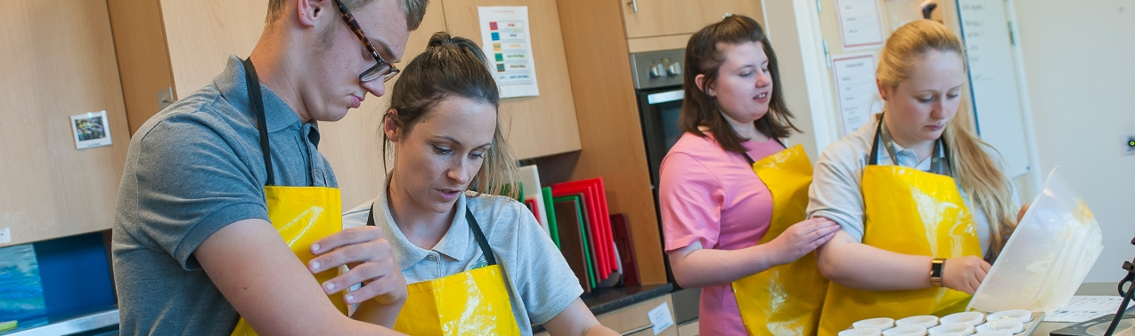 Pupils and teachers in a food technology lesson at Elms Bank